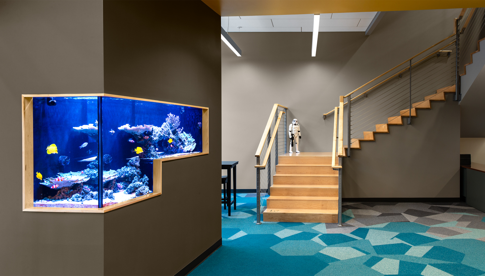 fish tank and stairs in the lobby of a building
